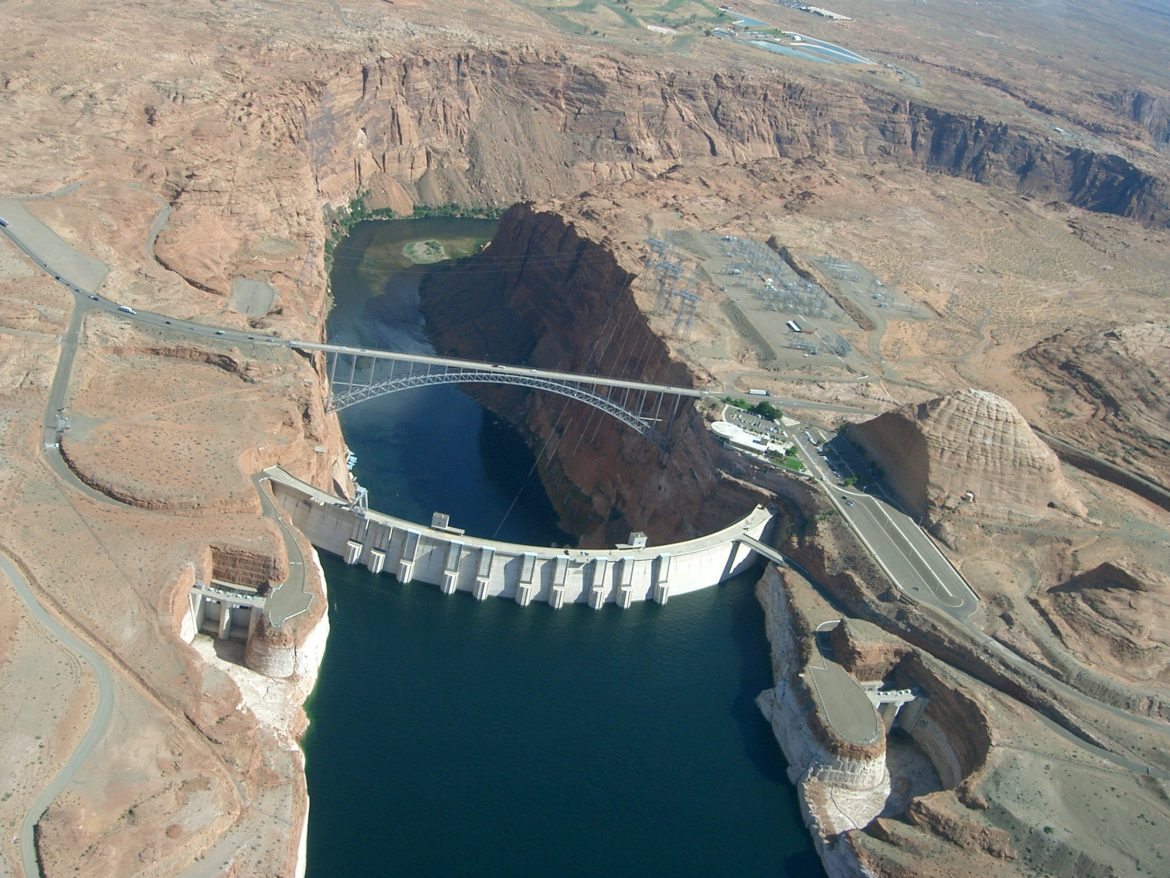Seen from the air, Glen Canyon Dam holds back the Colorado River to form Lake Powell. The state of Colorado is looking into how to fund a program that would pay irrigators to reduce their consumptive use in order to send water downstream to a savings account in Lake Powell. Courtesy Photo.