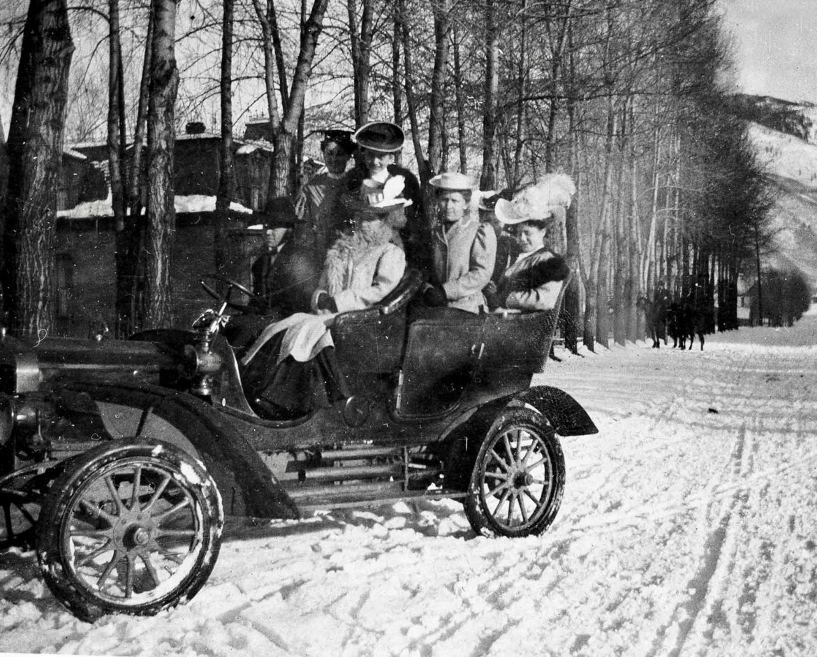 A new era had rolled into Aspen by 1907, when jaunty Ted Cooper, in his first car, took some high-fashion Aspen ladies out motoring, while two horseman follow behind. This photo was taken on the corner of Bleeker and Fourth streets, near Pioneer Park. Photo credit: AHS, Shaw Collection.