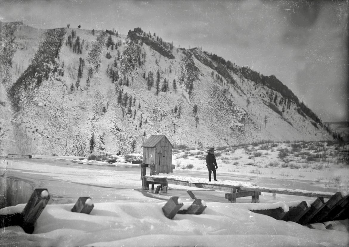 A young man tending to business in Aspen, 1900. The view is of West Aspen Mountain, now Shadow Mountain, possibly from the pond on the flats of the one-time Paepcke Ranch, or some former pond above today's William's Addition, above Centennial. Photo credit: Aspen Historical Society