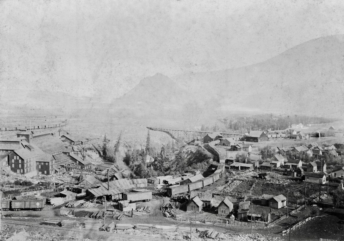 West Aspen in 1896. The City Sawmill was at the west end of Cooper Avenue across Castle Creek from the Holden Lixiviation Plant. Just on the edge of the ravine served by the train loop is the Aspen Smelting Company/Texas Smelter structure near the Castle Creek bridge. Waste from all three went into the Castle Creek before the Roaring Fork River junction. Red Butte is in the background. Photo credit: AHS, Shaw Collection